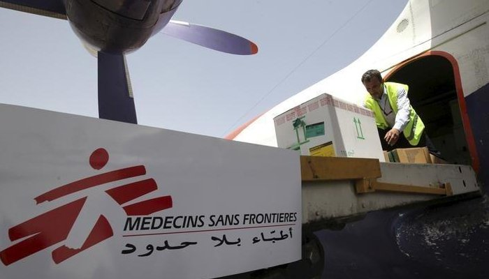 Workers unload emergency medical aid — sent by Medecins Sans Frontieres — from a plane, April 13, 2015. Credit: Reuters/Mohamed al-Sayaghi/Files