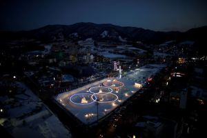 FILE PHOTO: An ice sculpture of the Olympic rings is illuminated during the Pyeongchang Winter Festival, near the venue for the opening and closing ceremony of the PyeongChang 2018 Winter Olympic Games in Pyeongchang, South Korea, February 10, 2017. Credit: Reuters/Kim Hong-Ji/File Photo