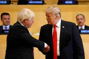 US President Donald Trump shakes hands with British Foreign Secretary Boris Johnson (L) as they take part in a session on reforming the United Nations at U.N. Headquarters in New York, September 18, 2017. Credit: Reuters/Kevin Lamarque