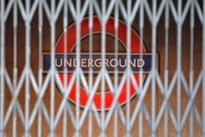 A London Underground sign is seen behind a locked gate, in central London December 26, 2010. Credit: Reuters
