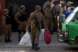 A soldier carries supplies to be delivered to a polling station from the election commission office in Lahore, Pakistan September 16, 2017. Credit: Reuters
