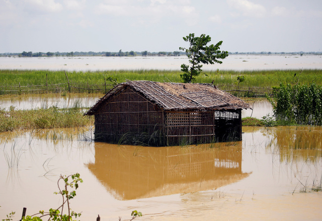 A farm house is submerged by flood water in Saptari District, Nepal August 14, 2017. Credit:Reuters