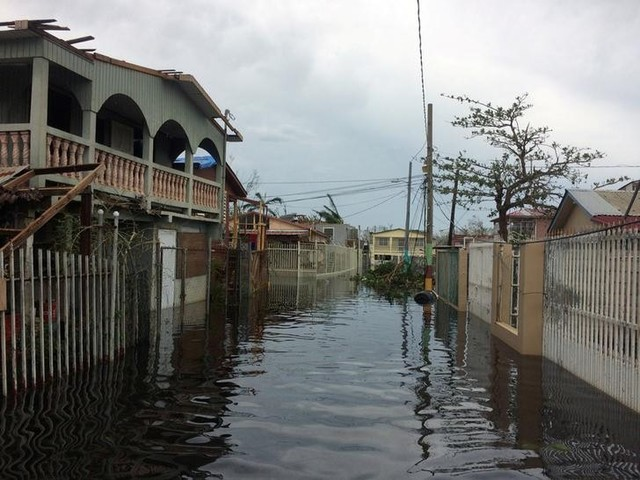 A flooded street is seen in the Juana Matos neighbourhood in Catano municipality after Hurricane Maria, southwest of San Juan, Puerto Rico on September 21, 2017. Credit: Reuters