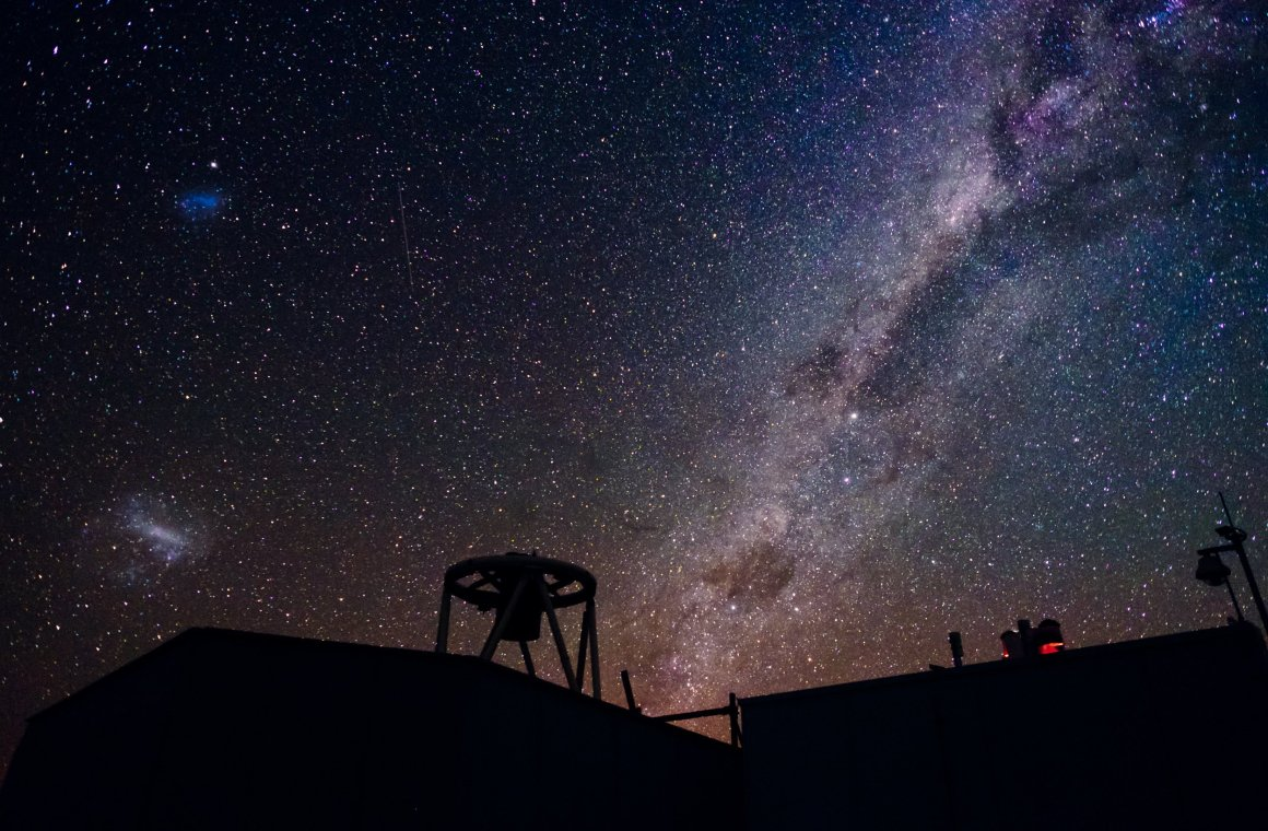 Faulkes Telescope South, Australia, with the Small and Large Magellanic Clouds visible in the sky. Credit: LCOGT