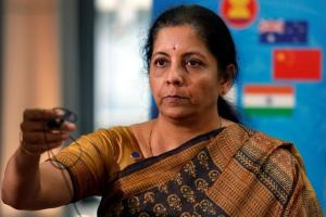Nirmala Sitharaman returns a microphone after speaking with media at the 3rd Intersessional Regional Comprehensive Economic Partnership (RCEP) Ministerial Meeting in Hanoi, Vietnam May 22, 2017. Credit: Reuters