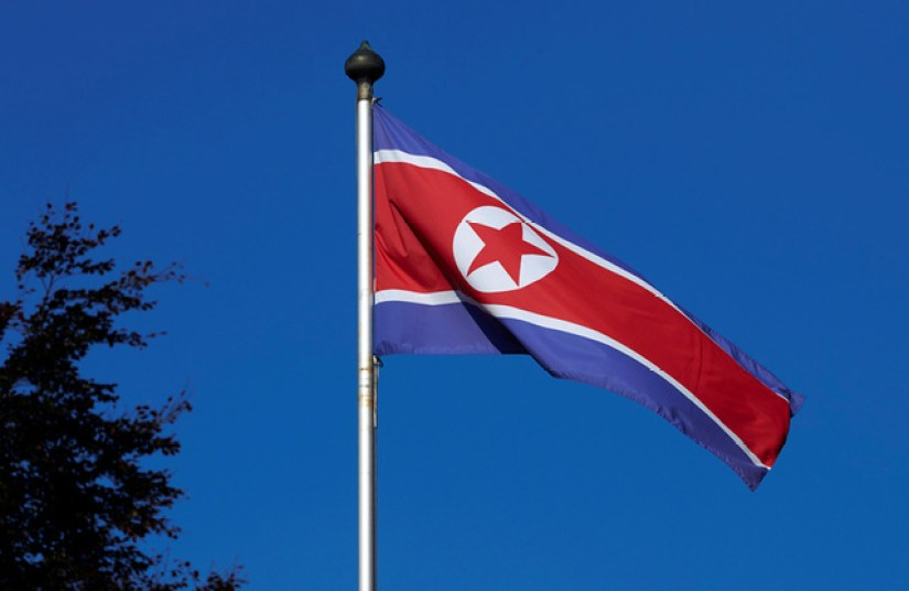 A North Korean flag flies on a mast at the Permanent Mission of North Korea in Geneva October 2, 2014. Credit: Reuters