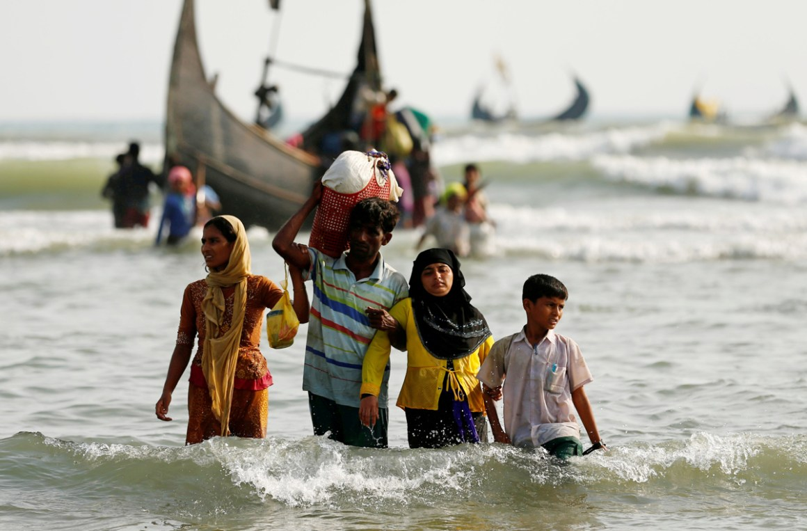 Rohingya refugees walk to the shore with his belongings after crossing the Bangladesh-Myanmar border by boat through the Bay of Bengal in Teknaf, Bangladesh, September 5, 2017. Credit: Reuters/Mohammad Ponir Hossain