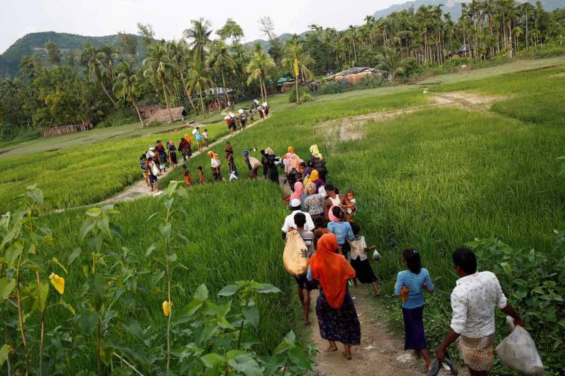 Rohingya refugees walk to the nearest village after crossing the Bangladesh-Myanmar border by boat through the Bay of Bengal in Teknaf, Bangladesh, September 5, 2017. Credit: Reuters/Mohammad Ponir Hossain