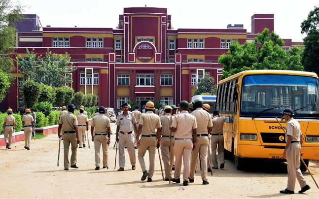 Policemen arrive at the Ryan International School in Gurgaon where a 7-year-old boy was found murdered on Friday morning. Credit: PTI