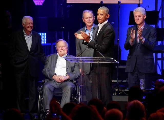 Five former US presidents, Jimmy Carter, George H.W. Bush, George W. Bush, Barack Obama and Bill Clintonspeak during a concert at Texas A&M University benefiting hurricane relief efforts in College Station, Texas, US, October 21, 2017. Credit: Reuters/Richard Carson
