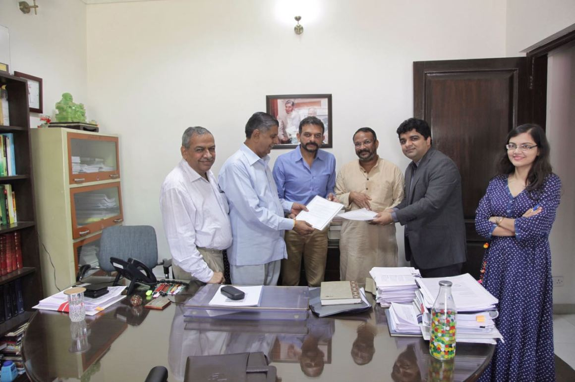 T.M. Krishna, Bezwada Wilson and Dushyant Arora present the draft bill to Justice Chauhan on October 11.