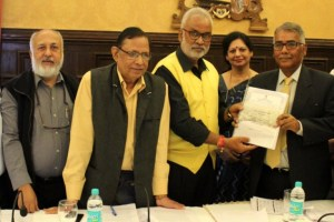 Justice C.K. Prasad releasing the Press Council of India report. Credit: Twitter/DIPR-Jammu and Kashmir