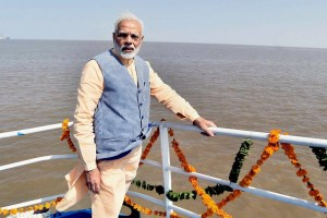 Bhavnagar: Prime Minister Narendra Modi on the maiden voyage of Ro-Ro Ferry Service between Ghogha and Dahej, after its inauguration in Ghogha, Bhavnagar, Gujarat on Sunday. PTI Photo / PIB (PTI10_22_2017_000098B) *** Local Caption ***
