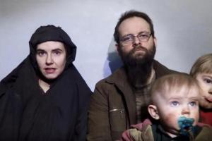 A still image from a video posted by the Taliban on social media on December 19, 2016 shows American Caitlan Coleman (L) speaking next to her Canadian husband Joshua Boyle and their two sons. Courtesy Taliban/Social media via Reuters