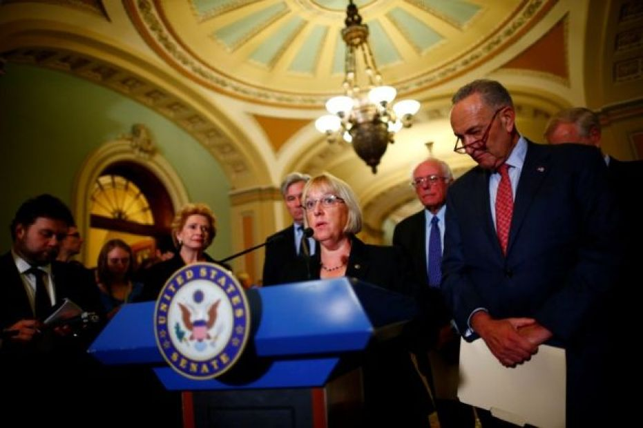 Senator Patty Murray (D-WA), flanked by Senate Minority Leader Chuck Schumer (D-NY), speaks to reporters following a policy luncheon on Capitol Hill in Washington, U.S. October 17, 2017. Credit: Reuters