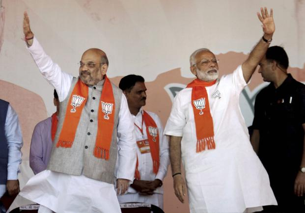 Prime Minister Narendra Modi with BJP president Amit Shah during the BJP rally in Gandhinagar. Credit: PTI