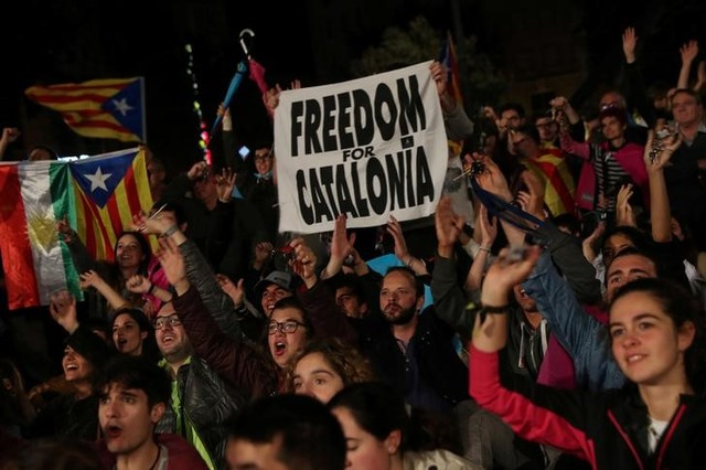 People react as they gather at Plaza Catalunya after voting ended for the banned independence referendum, in Barcelona, Spain October 1, 2017. Credit: Reuters