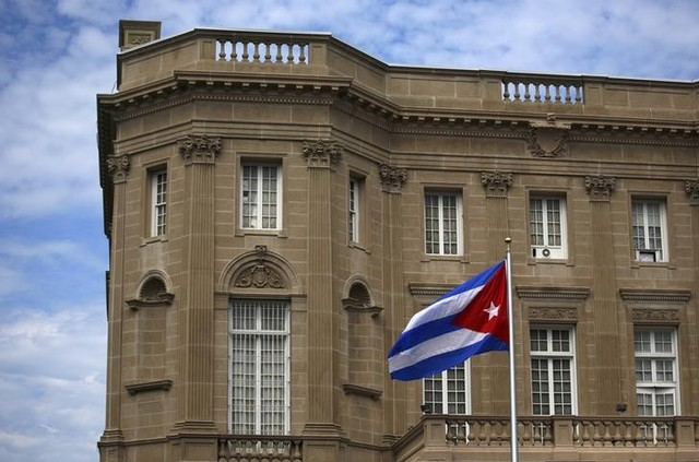 The Cuban national flag is seen raised over their new embassy in Washington July 20, 2015. Credit: Reuters