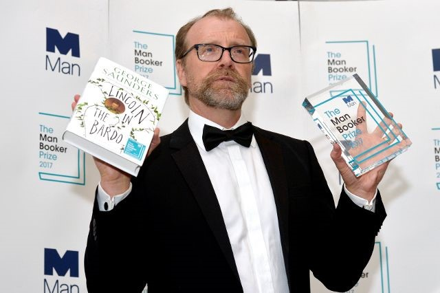 George Saunders, author of 'Lincoln in the Bardo', poses for photographers after winning the Man Booker Prize for Fiction 2017 in London, Britain, October 17, 2017. Credit: Reuters