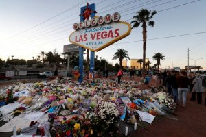 "The ""Welcome to Las Vegas"" sign is surrounded by flowers and items, left after the October 1 mass shooting, in Las Vegas, Nevada U.S. October 9, 2017. Credit: Reuters"