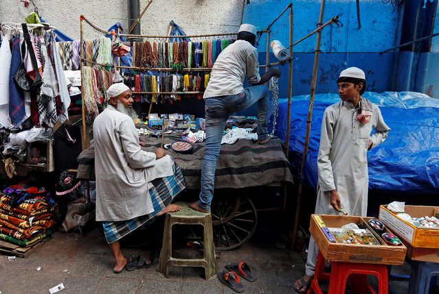 A street vendor sets up his stall outside the Nizamuddin Dargah in New Delhi. Credit: Reuters