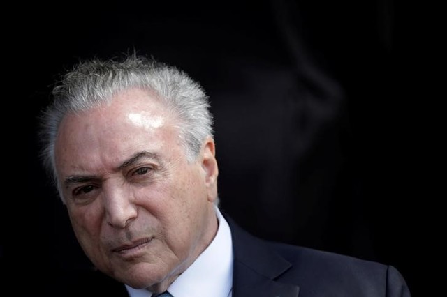 Brazil's President Michel Temer attends a ceremony to deliver the Order of Aeronautical Merit medals, in Brasilia, Brazil, October 23, 2017. Credit: Reuters