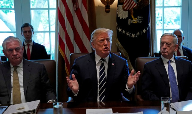 Flanked by Secretary of State Rex Tillerson and Defense Secretary James Mattis, U.S. President Donald Trump meets with members of his cabinet at the White House in Washington, U.S., October 16, 2017. Credit: Reuters