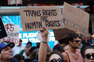 People protest US President Donald Trump's announcement that he plans to reinstate a ban on transgender individuals from serving in any capacity in the U.S. military, in Times Square, in New York City, New York, U.S., July 26, 2017. Credit: Reuters