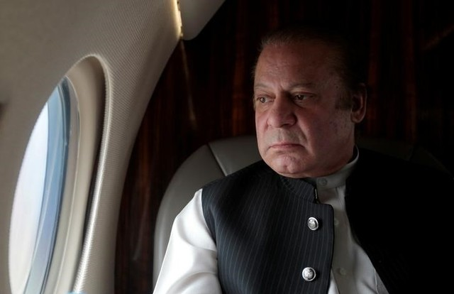 Pakistani Prime Minister Nawaz Sharif looks out the window of his plane after attending a ceremony to inaugurate the M9 motorway between Karachi and Hyderabad, Pakistan February 3, 2017. Credit: Reuters/Caren Firouz/Files