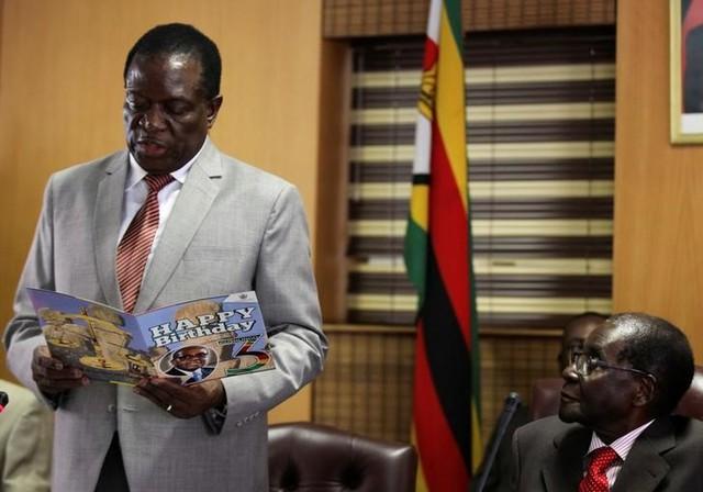 Zimbabwe's President Robert Mugabe looks on as his deputy Emmerson Mnangagwa reads a card during Mugabe's 93rd birthday celebrations in Harare, Zimbabwe, February 21, 2017. Credit: Reuters/Philimon Bulawayo