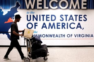 FILE PHOTO: A man exits the transit area after clearing immigration and customs on arrival at Dulles International Airport in Dulles, Virginia, U.S., September 24, 2017. Credit: Reuters/James Lawler Duggan/File Photo