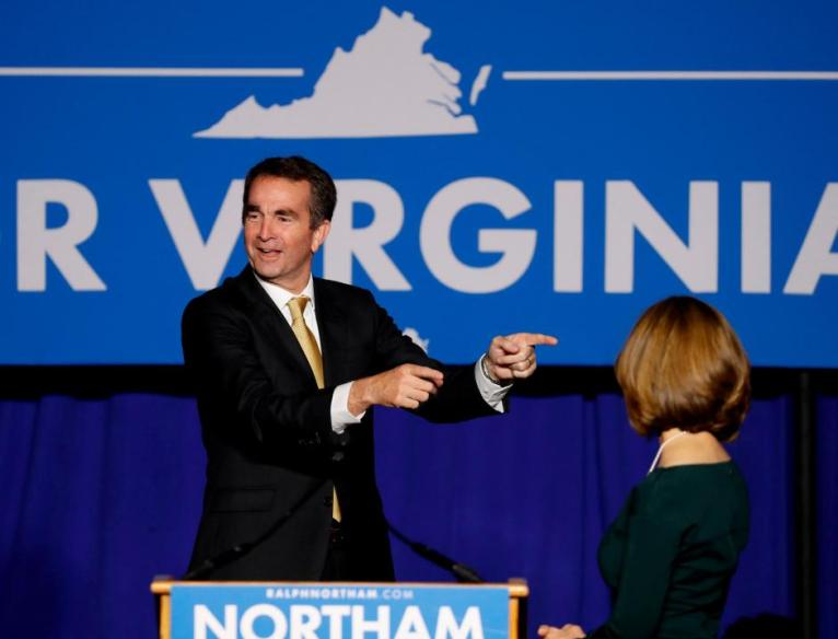 Democratic candidate for governor Ralph Northam speaks as his wife Pam looks on after his election night victory at the campus of George Mason University in Fairfax, Virginia, November 7, 2017. Credit: Reuters/Aaron P. Bernstein