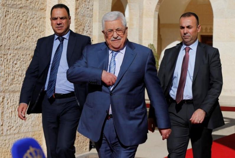 Palestinian President Mahmoud Abbas walks to speaks to the media after his meeting with Jordan's King Abdullah at the Royal Palace in Amman, Jordan October 22, 2017. Credit: Reuters/Muhammad Hamed