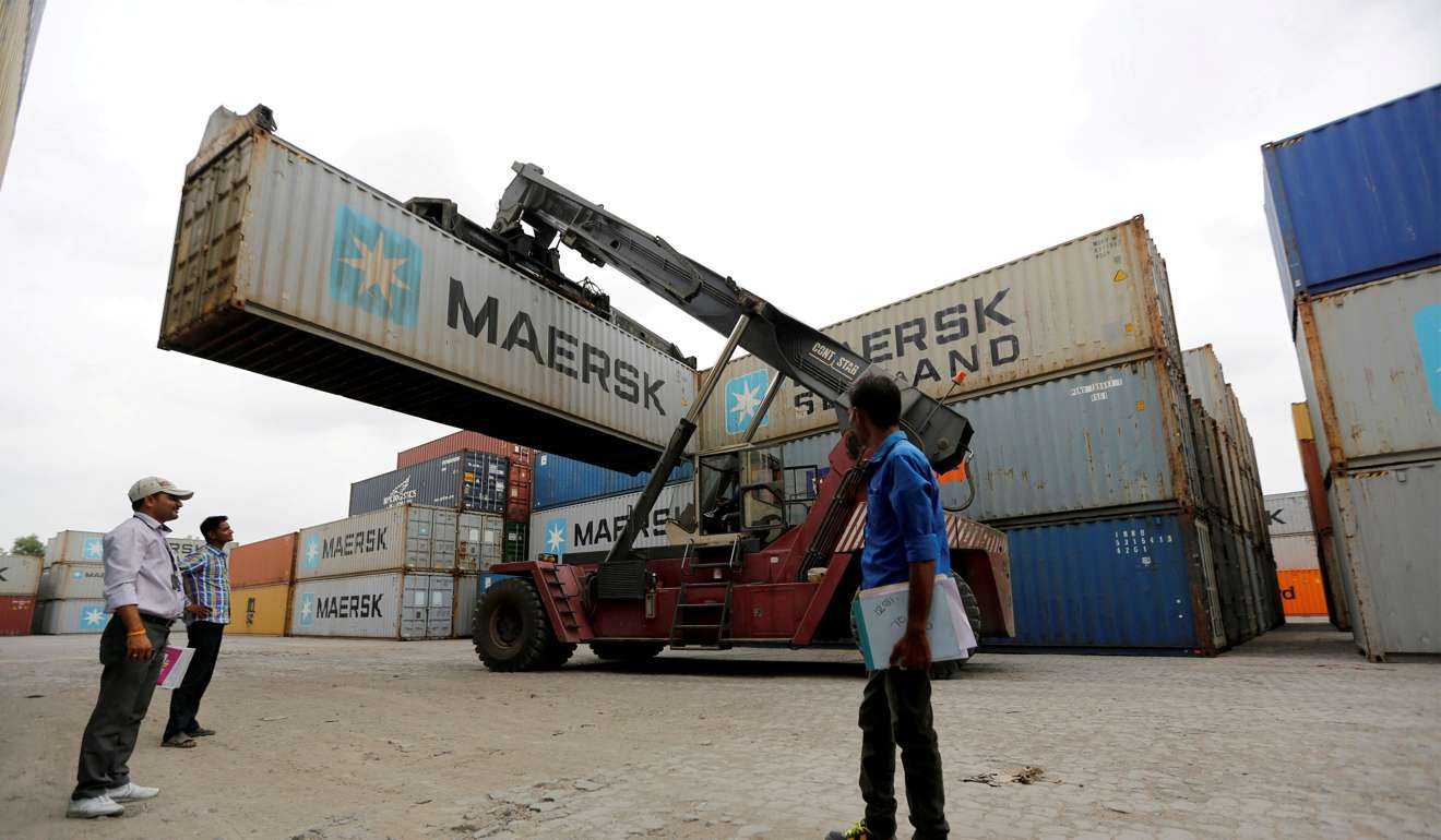 A mobile crane carries a container at Thar Dry Port in Sanand in Gujarat India. Credit Reuters