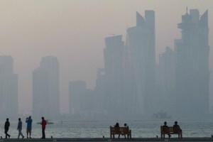 People sit on the corniche in Doha, Qatar, June 15, 2017. Credit: Reuters/Naseem Zeitoon