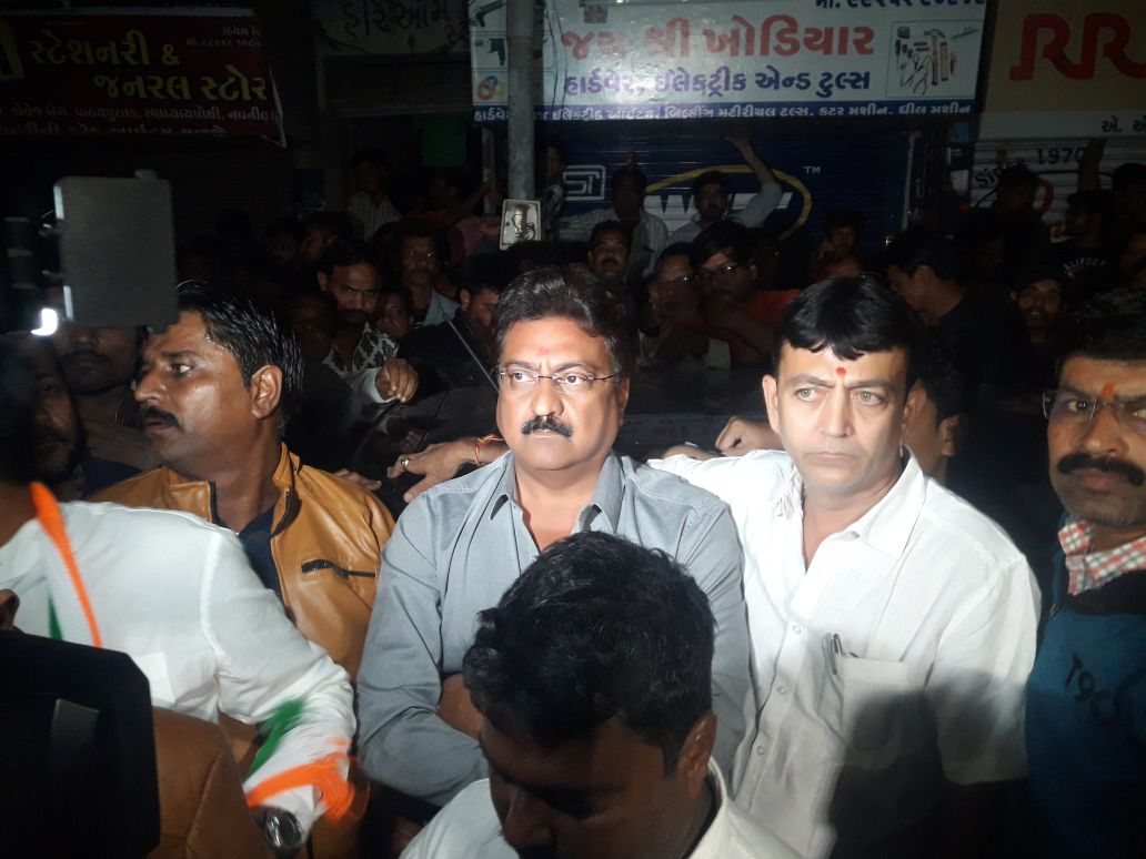 Indranil Rajguru along with other Congress leaders outside Vijay Rupani's residence. Credit: Damayantee Dhar