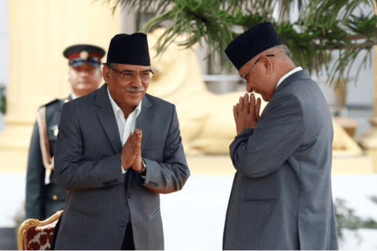 Pushpa Kamal Dahal, known as Prachanda, (left) greets K.P. Sharma Oli. Credit: Reuters
