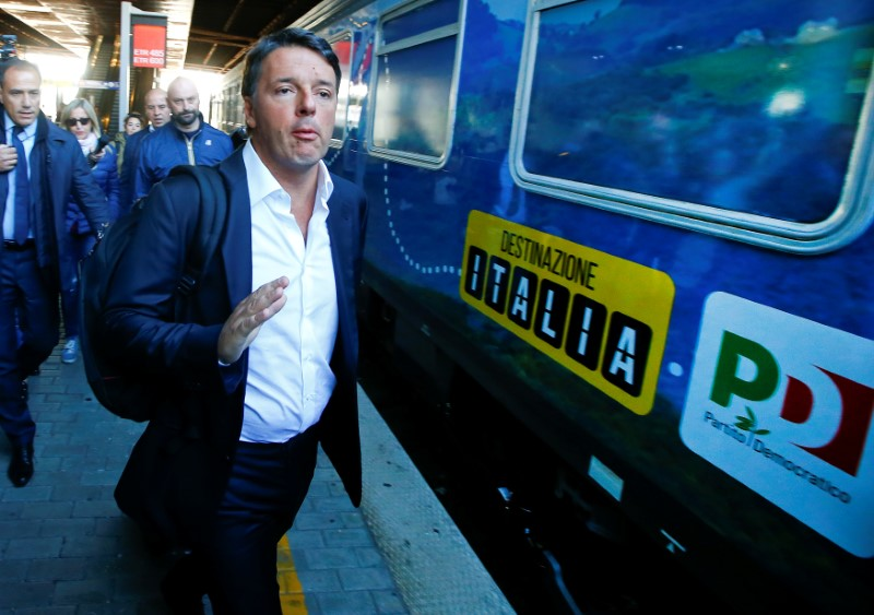 "Italy's Former Prime Minister Matteo Renzi arrives to board a train during his electoral tour ""Destinazione Italia"" (Destination Italy) at the Tiburtina train station in Rome, Italy October 17, 2017. Credit: Reuters/Tony Gentile"