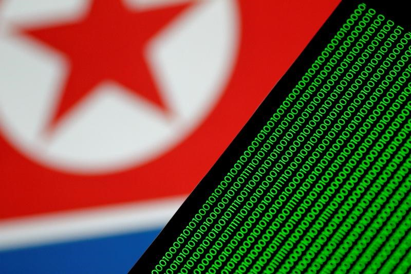 Binary code is seen on a screen against a North Korean flag in this illustration photo November 1, 2017. Credit: Reuters /Thomas White/