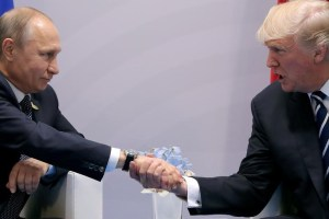 US President Donald Trump shakes hands with Russian President Vladimir Putin during the their bilateral meeting at the G20 summit in Hamburg, Germany July 7, 2017. Credit: Reuters/Carlos Barria