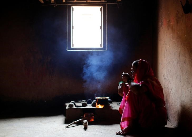 Kamal Keshavtupange, 60, who studies at Aajibaichi Shaala (Grandmothers' School), drinks tea inside her house in Fangane village, India, February 15, 2017. REUTERS/Danish Siddiqui
