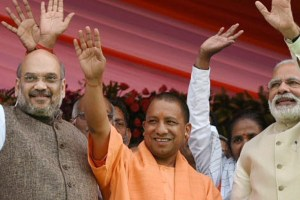 Lucknow: Prime Minister Narendra Modi and BJP President Amit Shah with the new Chief Minister Yogi Adityanath at the swearing-in ceremony of the new government of Uttar Pradesh, in Lucknow on Sunday. PTI Photo/ PIB(PTI3_19_2017_000159B)