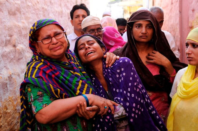 Family members of Mohammad Akhlaq (50-year-old man) mourn during his funeral at their village in Bisada on September 29, 2015 in Greater Noida, India. Akhlaq was beaten to death and his son critically injured by a mob over an allegation of storing and consuming beef at home, late night on Monday, in UPs Dadri. Police and PAC were immediately deployed in the village to maintain law and order. Six persons were arrested in connection with the killing of man. PTI