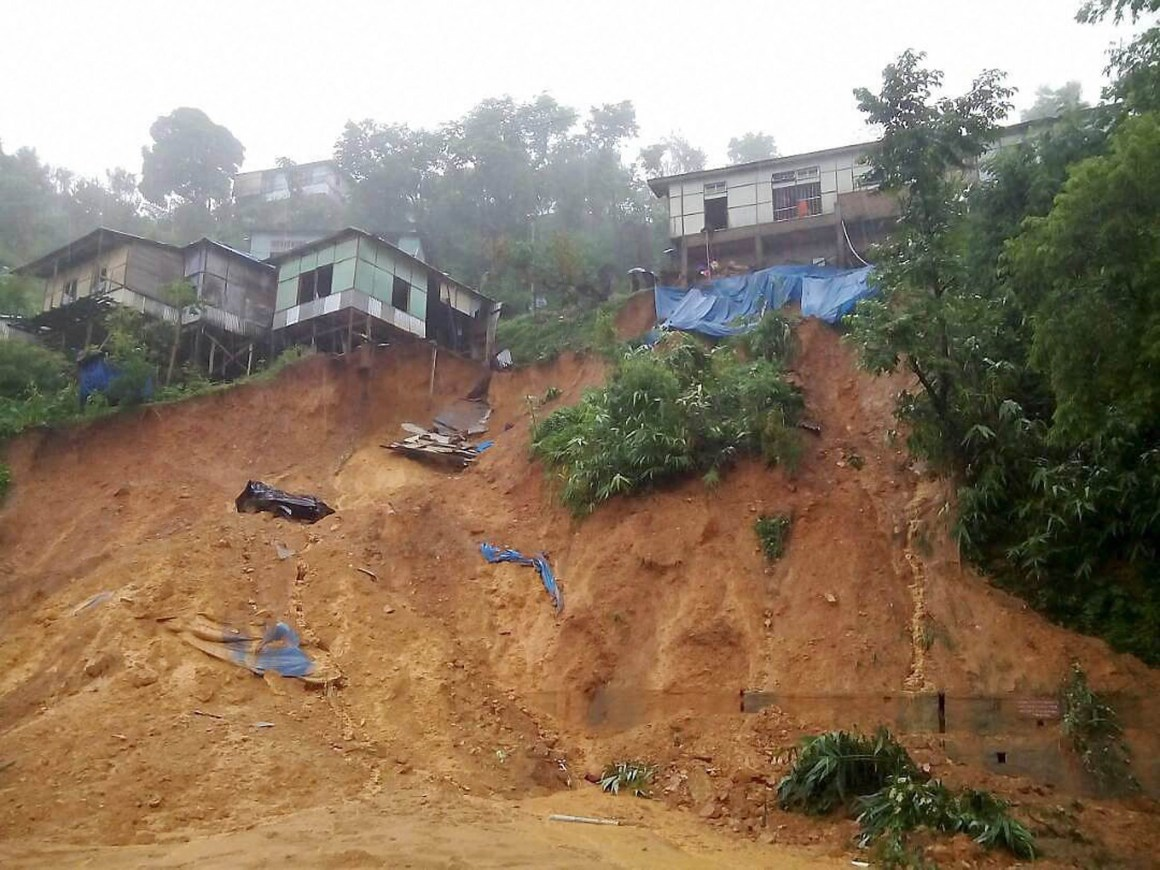 Aizawl: The earth under the buildings caves in after heavy rains triggered landslides in Aizawl, Mizoram on Tuesday. PTI Photo (PTI6_14_2017_000058B)