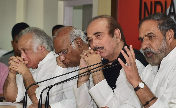 New Delhi: Senior Congress leaders Ghulam Nabi Azad, Mallikarjun Kharge, Aanad Sharma and Jairam Ramesh during a press conference to announce their boycott of parliament's mid-night session to rollout GST on June 30, in New Delhi on Thursday. PTI Photo by Manvender Vashist  (PTI6_29_2017_000213A)