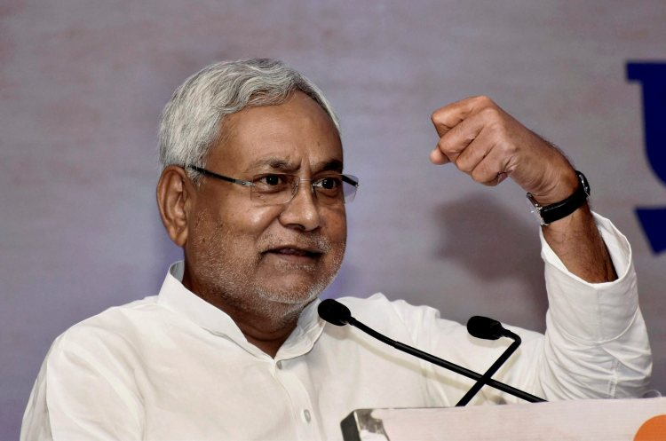 Patna: Bihar Chief Minister Nitish Kumar addressing at National Conference of Champaran Satyagrah centenary celebrations at Maurya hotel, in Patna on Tuesday. PTI Photo (PTI5_23_2017_000051B)