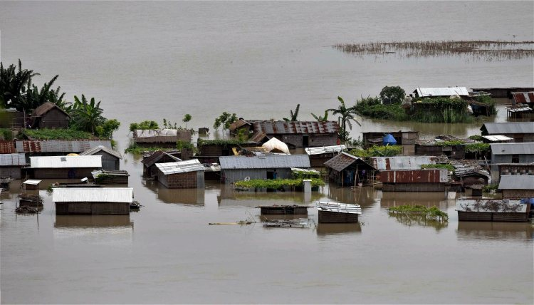 Morigaon: A view of the flooded Katoguri village in Morigaon district of Assam on Thursday. PTI Photo (PTI7_6_2017_000183B)