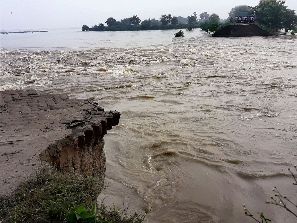 Gopalganj : A damage dam in flood affected Gopalganj on Wednesday. PTI Photo (PTI8 16 2017 000092B)