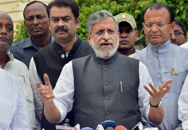 Patna: Bihar Deputy Chief Minister Sushil Kumar Modi speaks to the media outside the Bihar Assembly in Patna on Wednesday. PTI Photo (PTI8_23_2017_000031A)