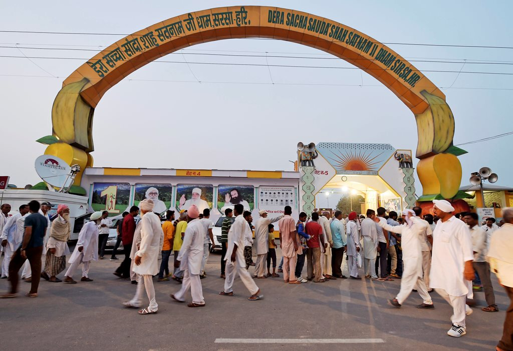 Sirsa: Followers of Dera Sacha Sauda chief Gurmeet Ram Rahim Singh gather at his ashram in Sirsa on Thursday, ahead of the verdict in the rape trial of Ram Rahim. PTI Photo by Vijay Verma (PTI8 24 2017 000195B)